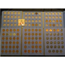 Pair of Whitman Lincoln Cent coins folders with Cents dating from 1918 S through 1964.