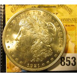 1921 P U.S. Morgan Silver Dollar. Brilliant Uncirculated. Gold and amber reverse toning.
