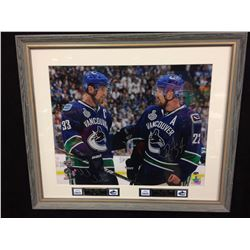 "DANIEL & HENRIK SEDIN AUTOGRAPHED 23"" X 27"" FRAMED PHOTO (GAME DAY COA)"