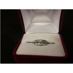 14 KT CANADIAN DIAMOND (.57 TCW) SOLITAIRE FANCY ENGAGEMENT RING W/ 14 KT DIAMOND CHANNEL SET BAND