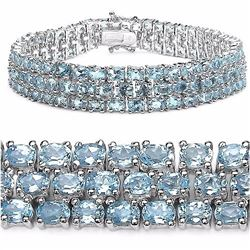 STERLING SILVER BLUE TOPAZ TRIPLE ROW BRACELET