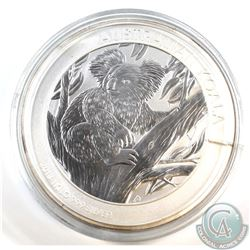 2013 Australia $30 Koala 1 Kilo .999 Fine Silver Coin (lightly toned, cracked capsule). TAX Exempt