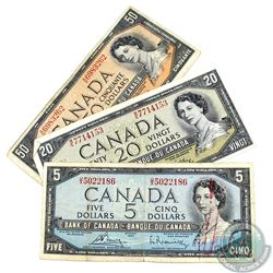 Group lot of three 1954 modified portrait banknotes in average circulated condition.  Included is a