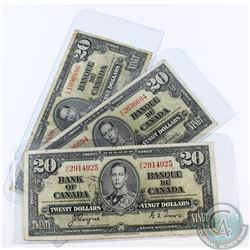 Group lot of three 1937 $20.00 notes in F-VF or better condition.  Notes contain holes, tears or wri