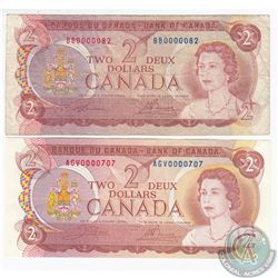 Pair of low serial number $2.00 notes in circulated condition.  2 pcs.