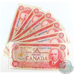 6 x 1975 $50.00 notes featuring the RCMP Musical Ride in average circualted condition.  5 pcs.