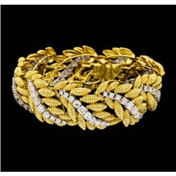 18K Yellow and White Gold 9.60ctw Diamond Floral Bracelet