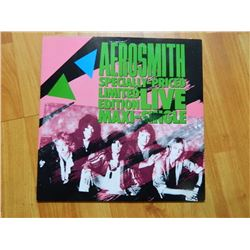 VINYL RECORD - AEROSMITH - SPECIAL PRICED LIMITED EDITION LIVE MAXI SINGLE - 92 05010 - 45 RPM - con