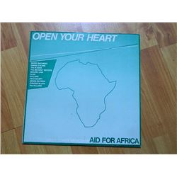VINYL RECORD - OPEN YOUR HEART - AID FOR AFRICA - OXFAM 002 - condition - really good