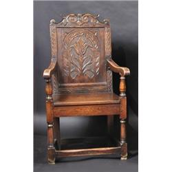 An Oak Wainscot Chair, The Acanthus Carved Scrolling Top Rail Above A  Floral Carved Panel Back, Dow.