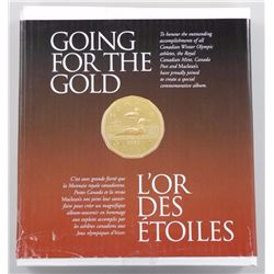 Going for the Gold Commemorative Album.