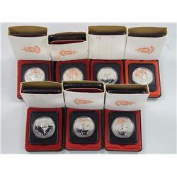 7x Cased Silver Dollars.