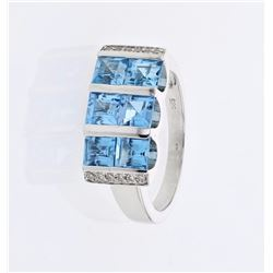 18KT White Gold 2.54ctw Blue Topaz and Diamond Ring