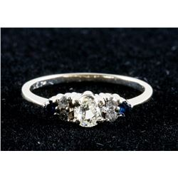 0.3ct Diamond and 0.03ct Dark Blue Sapphire Ring