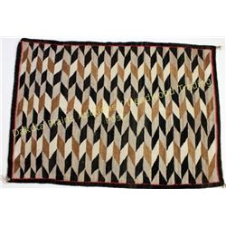 "Good Navajo rug in tan, white and brown's, diamond pattern showing good overall condition, 36"" X 51"""