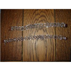 Pair of Marked Sterling silver charm bracelets