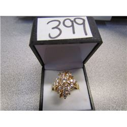 Gold Colored Band fashion ring with white/clear stones