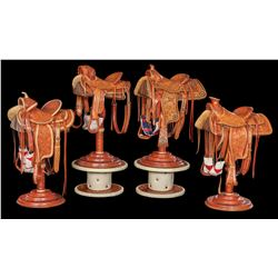 Collection of Duff Severe Salesman Sample-Size Display Saddles