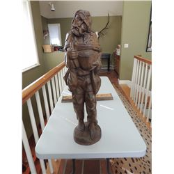 """Wood Sculpture of a Farmer 32""""H x 9""""W $85 to $170"""