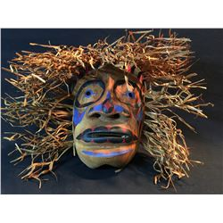 BRAD BAZILLE, HAND CARVED AND PAINTED WILD MAN MASK, APPROX. 23'' WIDE, WITH CEDAR BARK HAIR