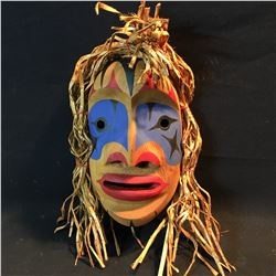 BRAD BAZILLE, HAND CARVED AND PAINTED WILD WOMAN MASK, APPROX. 22'' TALL, WITH CEDAR BARK HAIR