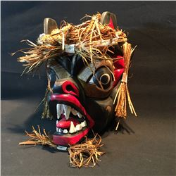 JOHN JOHNSTON, HAND CARVED AND PAINTED BEAR MASK, WITH WOVEN CEDAR BARK ACCENTS, SIGNED BY ARTIST