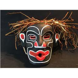 ANDY WESLEY, OF TSU-ECH NATION, HAND CARVED AND PAINTED WILD MAN MASK WITH CEDAR BARK ACCENTS,