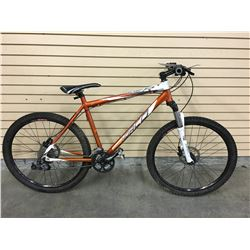 ORANGE NORCO CHARGER FRONT SUSPENSION MOUNTAIN BIKE WITH FRONT AND REAR HYDRAULIC DISK BRAKES, 20''