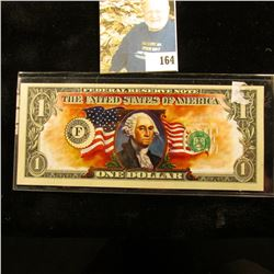 """Series 2003 One Dollar """"Colarized"""" George Washington with U.S. Flag Federal Reserve Note, CU."""