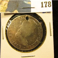 "1819 SILVER 4 REALES HOLED.  THIS BOOKS FOR $175 IN VERY GOOD.  THIS IS A GOOD ""HOLE FILLER"" FOR YOU"