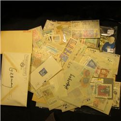 Large group of foreign cancelled stamps, this one includes an envelope of German WWII era & examples