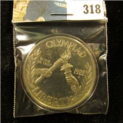 1988 S U.S. Olympics Proof Silver Dollar, encapsulated.