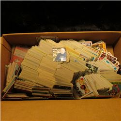 Maybe as much as 2,000 old Football Cards in a cardboard box, various players. It looks like they da