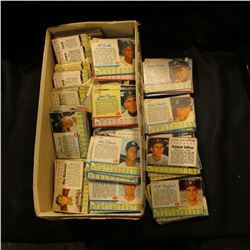 """Shoe box more than half full of """"Post"""" Cereal Box cut-out Baseball Cards from the early 1960 era."""