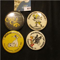 (4) Different 1970-80 Hawkeye Homecoming Pin-backs. One is missing pin.