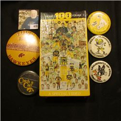 """(5) Different 1970-80 Hawkeye Homecoming Pin-backs; & an original wrapped VHS tape """"100 Years of Iow"""