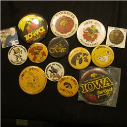 (12) Different 1970-80 Hawkeye Homecoming Pin-backs; & 1994-95 Iowa Sports Schedule 39mm brass medal