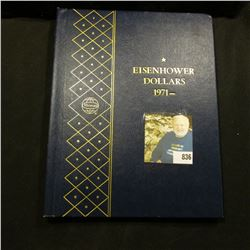 1971-78 Partial Set of Eisenhower Dollars in a deluxe Whitman album. (14 pcs.).