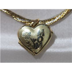 10KT GOLD LOCKET HEART SHAPED PENDANT ON HIGH FASHION CORD RETAIL VALUE $500