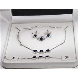 STERLING SILVER NECKLACE, BRACELET, EARRINGS AND RING WITH SAPPHIRE(20CT) CUSTOM DESIGN