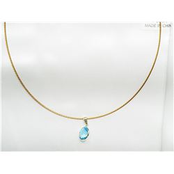 14KT GOLD PENDANT WITH LASER CUT BLUE TOPAZ(2CT) ON HIGH FASHION CORD HANDCRAFTED IN CANADA