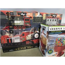 FAO SCHWARZ 34-PIECE MOTORIZED TRAIN SET/SHARPER IMAGE CANDY DISPENSER