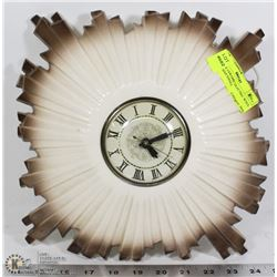 VINTAGE CERAMIC ELECTRIC WALL CLOCK. HAS SMALL