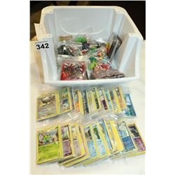 TRAY OF POKEMAN CARDS AND POKEMAN ITEMS