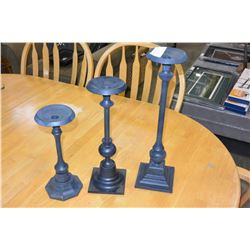 THREE METAL CANDLESTICKS