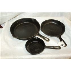 THREE CAST IRON FRY PANS