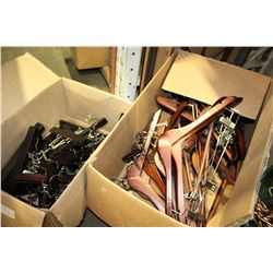 TWO BOXES OF WOODEN COAT HANGERS