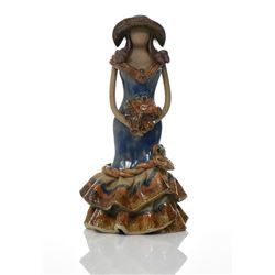 Glazed Ceramic Figure Of A Woman Holding A