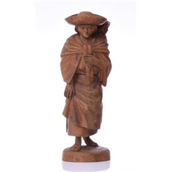 Carved Wood Sculpture Of A Woman Traveling