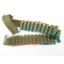 ASSORTED LOT OF 12 GA X 2/1/2 SHOTGUN SHELLS ON CANVAS AMMO BELT
